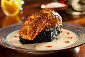 foto of crisps  - Crisp Salmon Steak with Black Risotto and Cream Sauce - JPG