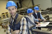 foto of mechanical engineer  - Portrait of cheerful industrial engineer - JPG
