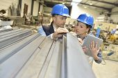 picture of mechanical engineering  - Supplier with engineer checking on production in factory - JPG