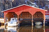Постер, плакат: Red Wooden Garage For Three Boats