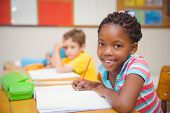 image of pupils  - Cute pupils drawing at their desks one smiling at camera at the elementary school - JPG