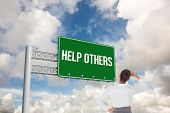 image of helping others  - The word help others and businesswoman scratching her head against blue sky with white clouds - JPG