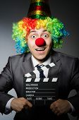 image of clowns  - Clown with the movie board - JPG