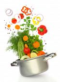 foto of vegetable soup  - Fresh vegetables coming out of a cooking pot - JPG