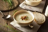 stock photo of leek  - Homemade Creamy Potato and Leek Soup in a Bowl