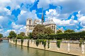 stock photo of notre dame  - Seine and Notre Dame de Paris is the one of the most famous symbols of Paris - JPG
