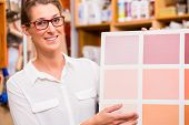 image of interior decorator  - Interior Designer with paint sample card - JPG