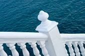 foto of balustrade  - White balustrade with ocean blue background Mediterranean colors - JPG