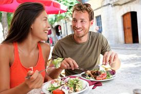 image of cafe  - Restaurant tourists couple eating at outdoor cafe - JPG