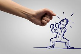 stock photo of caricatures  - Close up of human fist fighting with businessman caricature - JPG