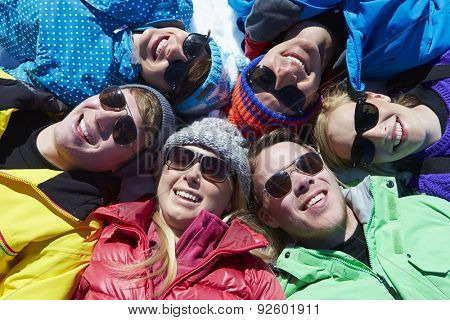 Overhead Shot Of Friends Having Fun On Winter Holiday