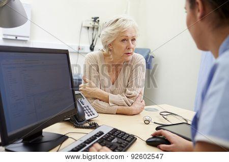 Senior Female Patient Has Appointment With Nurse