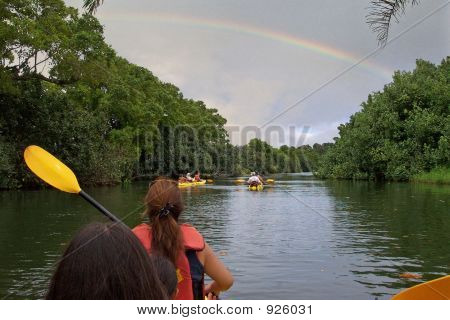 Kayaking In Kauai Under A Rainbow
