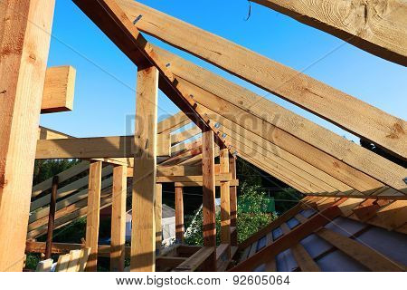 Installation Of Wooden Beams At Construction Of The Frame House