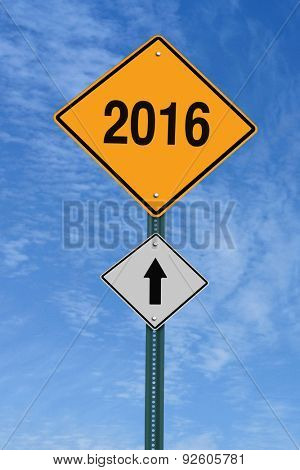 2016 ahead road sign over blue sky with clouds