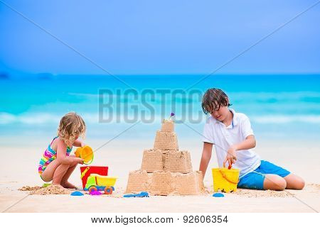 Kids Building Sand Castle On The Beach