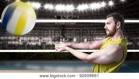 Volleyball player on yellow uniform in volleyball court.