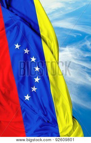 Venezuelan waving flag on a beautiful day