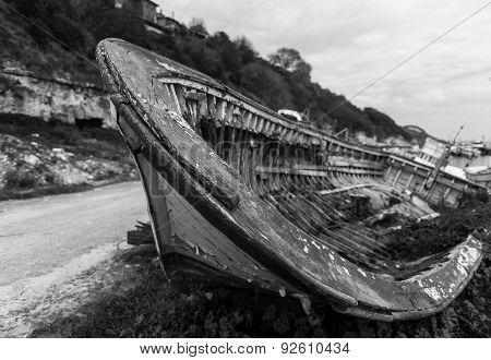 Old boat abandoned on mud