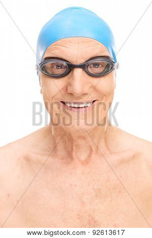 Close-up on a senior man with a blue swimming cap and black swim goggles isolated on white background