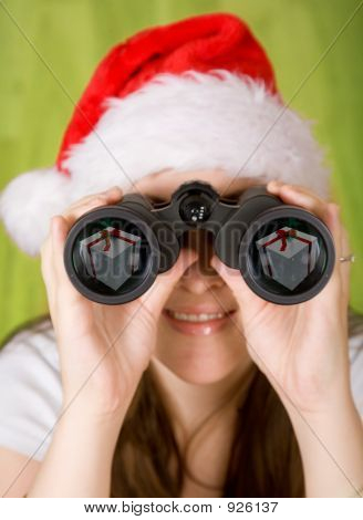 Female Santa Searching For Gifts