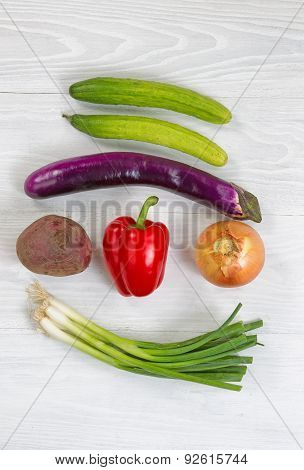 Freshly Picked Vegetables On White Wood Background
