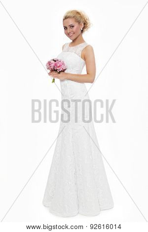 Young slim beautiful blonde happy smiling bride in lacy dress over white background