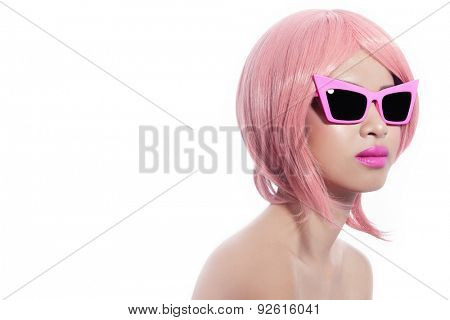 Young beautiful asian girl with stylish pink bob haircut in freaky vintage sunglasses over white background