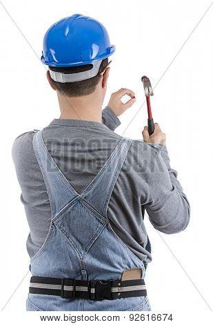 Carpenter nailing the wall with hammer isolated on white.