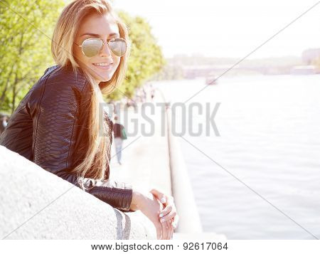 Portrait of young woman. Natural sunflare