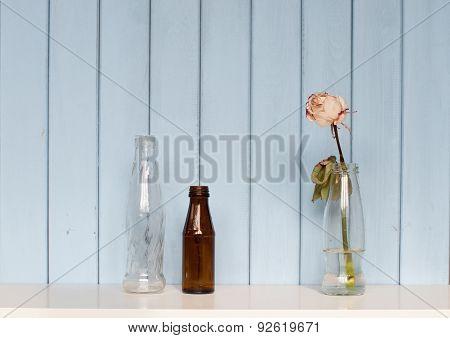Three Bottles And White Rose