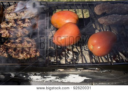 Kabobs and Tomatoes on a charcoal grill