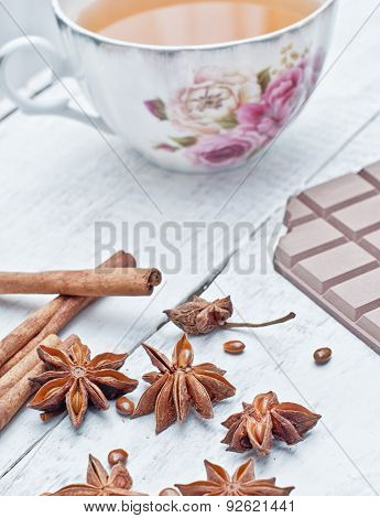 Cinnamon Stick, Star Anise, Bar Of Chocolate And Cup Of Tea