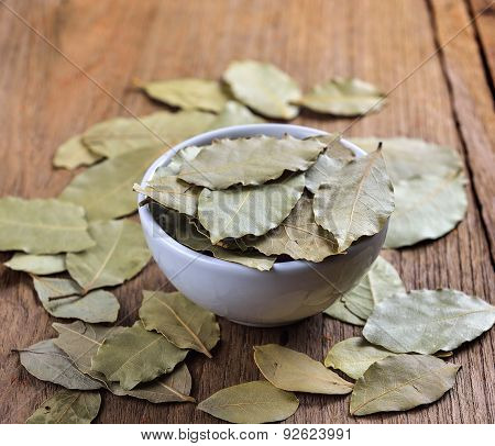 Bay Leaves In White Ceramic Bowl On Wood