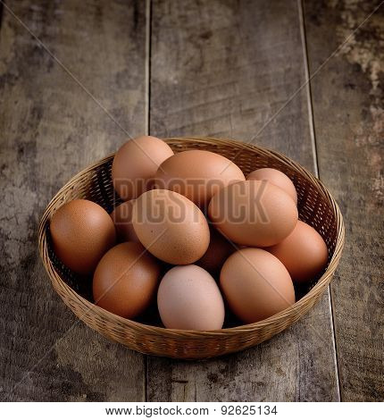 Egg In A Basket On Wodden Table