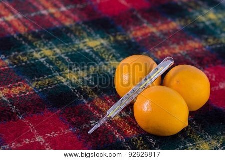 Lemons And Thermometer