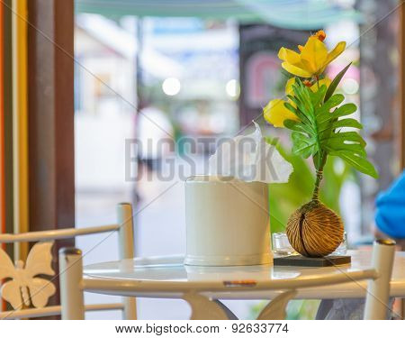 Small Tree And Flower On A Wood Table.