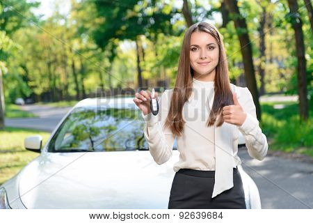 Young girl showing car keys