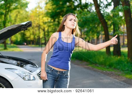 Woman trying to catch car
