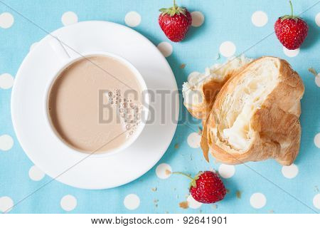 Concept perfect lunch or breakfast. A cup coffee latte with a piece of traditional French croissant