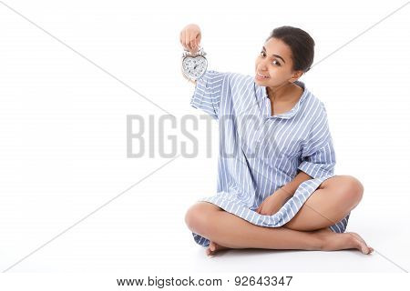 Pretty young mulatto girl holding alarm clock