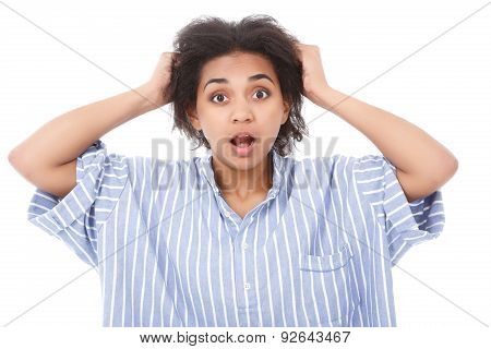 Shocked mulatto girl against isolated background