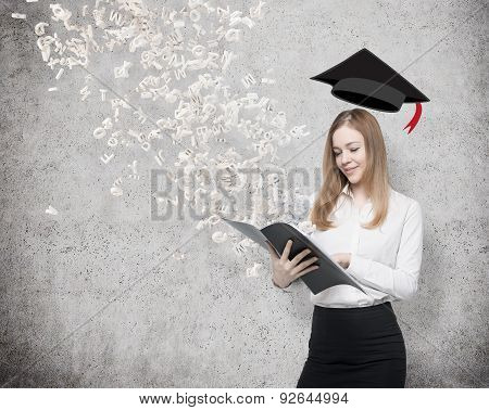 A Beautiful Student Is Holding A Black Folder With Flying Out Letters From The Folder. Graduation Ha