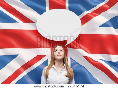 Beautiful Woman And The Blank Speech Bubble Above The Head. Great Britain Flag As A Background.