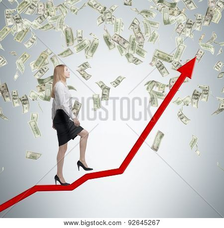 Full-length Business Lady Is Going Up Using The Red Arrow As A Stair. A Concept Of The Growth In Eco