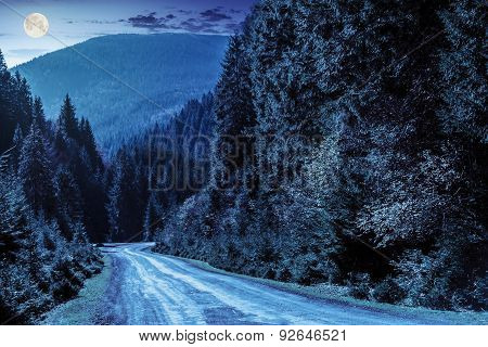 Road Through The Forest In Mountains At Night