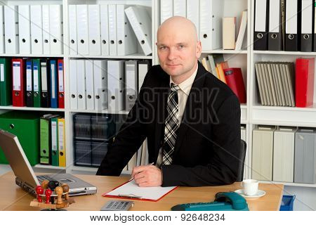 Young Businessman Is Looking Friendly In To The Camera