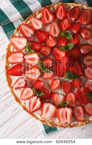 Homemade Strawberry Tart With Mint Vertical Top View Closeup