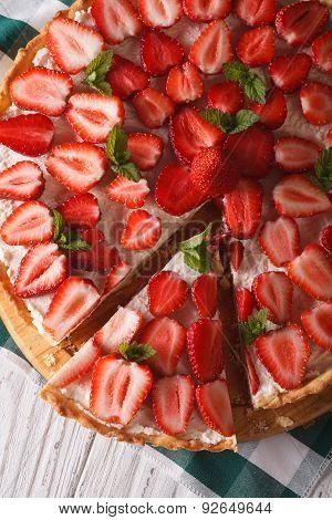 Sliced Strawberry Tart Closeup. Vertical Top View