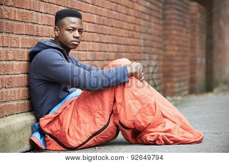 Vulnerable Teenage Boy Sleeping On The Street